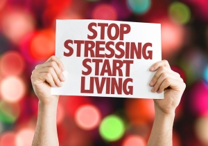 Stop-Stressing-Start-Living-placard-with-bokeh-background-000074895569_Large